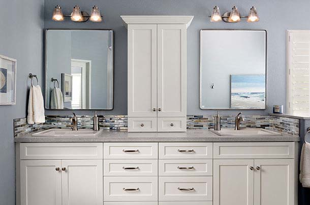 White bathroom cabinets, two mirrors and two sinks - large image