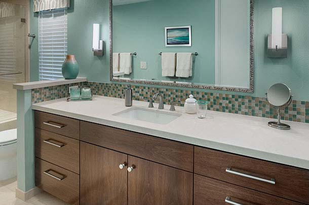 Large bathroom sink countertop, dark cabinets, sconces - large image