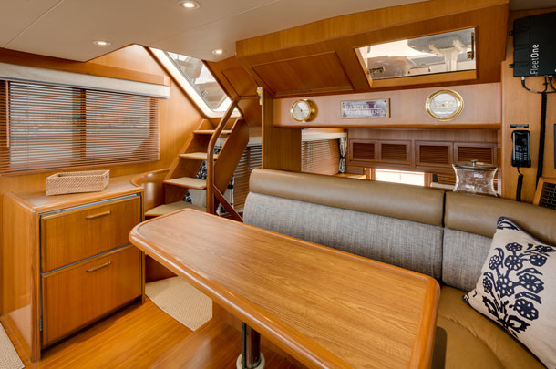 Yacht living area showing stairs to deck - large image