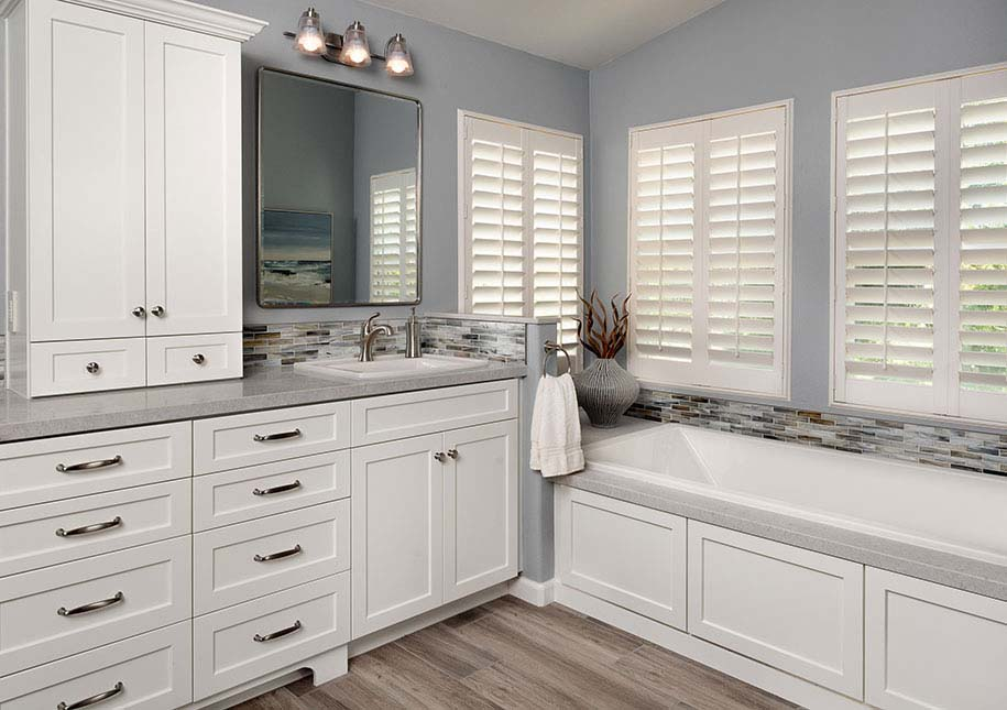 White cabinetry, bath and large mirror - x-large photo