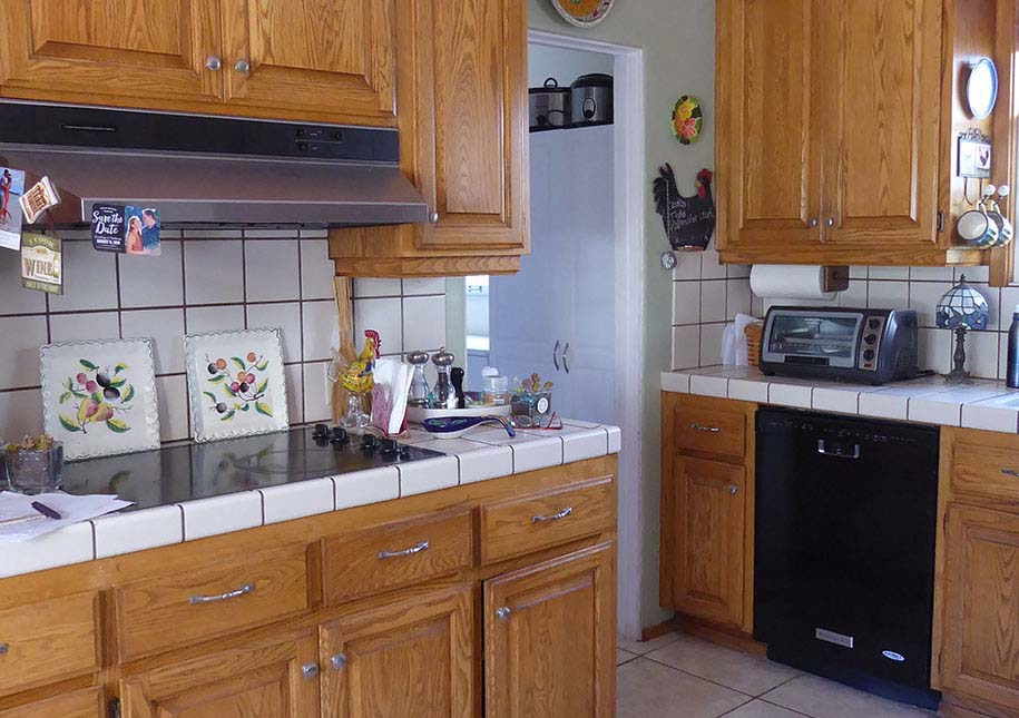 BEFORE: Dark cabinets, out-dated counter tile - x-large photo