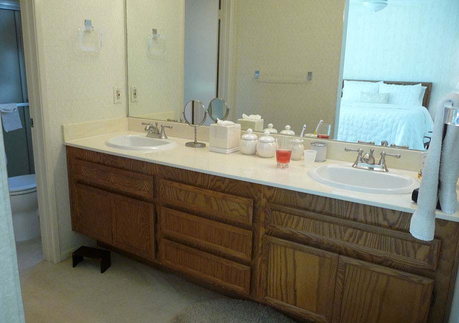 BEFORE: large wall mirror, two sinks in bathroom - x-large photo